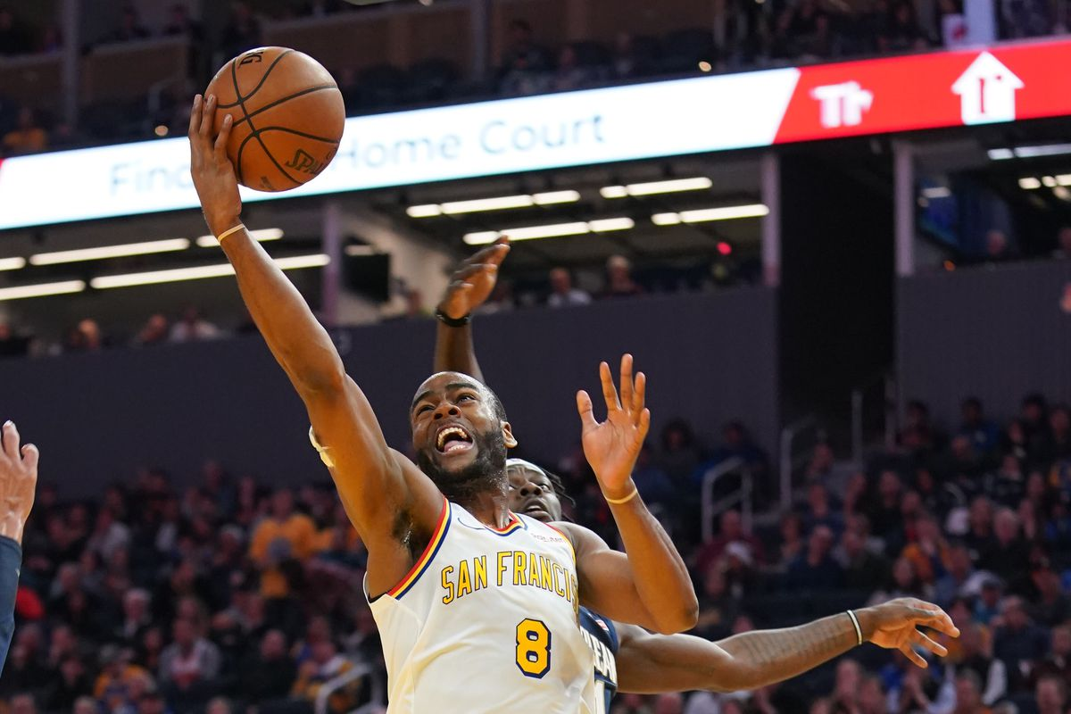 Golden State Warriors guard Alec Burks shoots the basketball against New Orleans Pelicans guard Jrue Holiday during the fourth quarter at Chase Center.