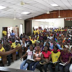 Church members in Port-Au-Prince, Haiti, sing hymns during a devotional held prior to a massive, country-wide service project on May 1.  As part of the project, and as a symbol of hope to their earthquake-devastated country, members planted legions of saplings.