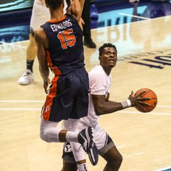 Brigham Young Cougars forward Gideon George (5) shoots the ball over Pepperdine Waves forward Kessler Edwards (15) at the Marriott Center in Provo on Saturday, Jan. 23, 2021.