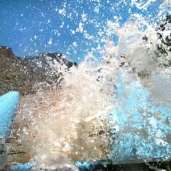 Water splashes up over the boat during river rafting down Cataract Canyon in Moab on the Colorado River Monday June 13, 2005.