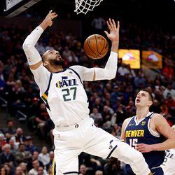 Utah Jazz center Rudy Gobert (27) dunks the ball over Denver Nuggets center Nikola Jokic (15) as the Utah Jazz and the Denver Nuggets play an NBA basketball game at Vivint Arena in Salt Lake City on Wednesday, Feb. 5, 2020.