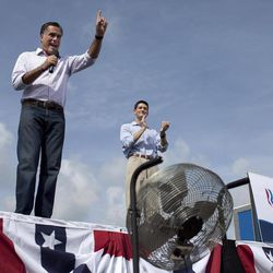 Republican presidential candidate, former Massachusetts Gov. Mitt Romney, accompanied by his vice presidential running mate Rep. Paul Ryan, R-Wis. speaks during a campaign stop, Friday, Aug. 31, 2012, in Lakeland, Fla.