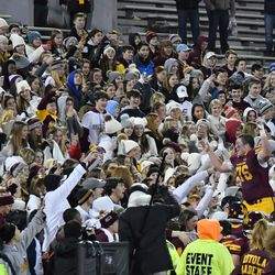 Loyola's Christo Kelly (76) runs an jumps into the stands. Worsom Robinson/For the Sun-Times.