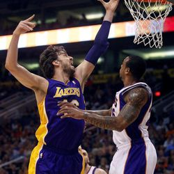 Los Angeles Lakers' Pau Gasol, of Spain, left, shoots over Phoneix Suns' Shannon Brown during the first half of an NBA basketball game, Saturday, April 7, 2012, in Phoenix.