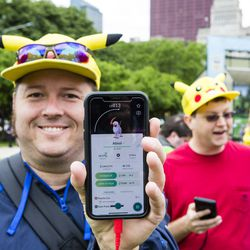 Jeremiah Johnsen shows a Shining Absol Pokemon that he found at the 2019 Pokémon Go Fest, Grant Park, Thursday, June 13th, 2019.