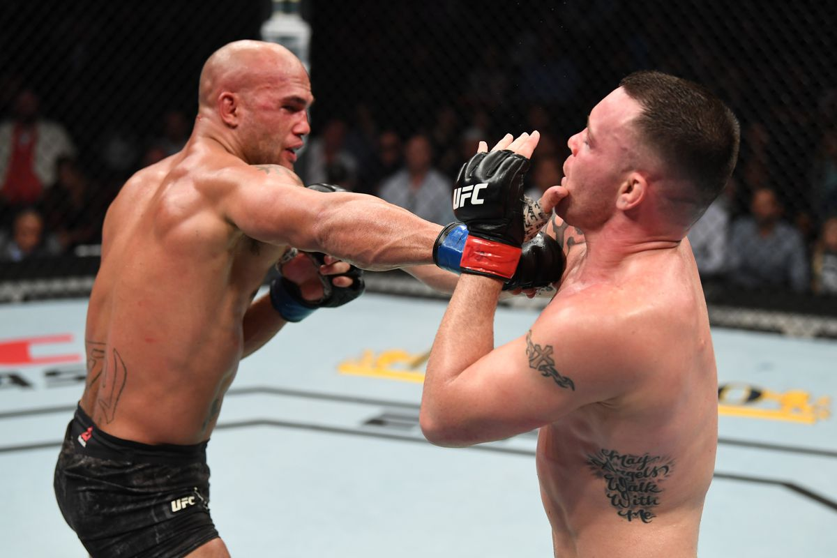 Robbie Lawler punches Colby Covington in their welterweight bout during the UFC Fight Night event at the Prudential Center on August 3, 2019 in Newark, New Jersey.
