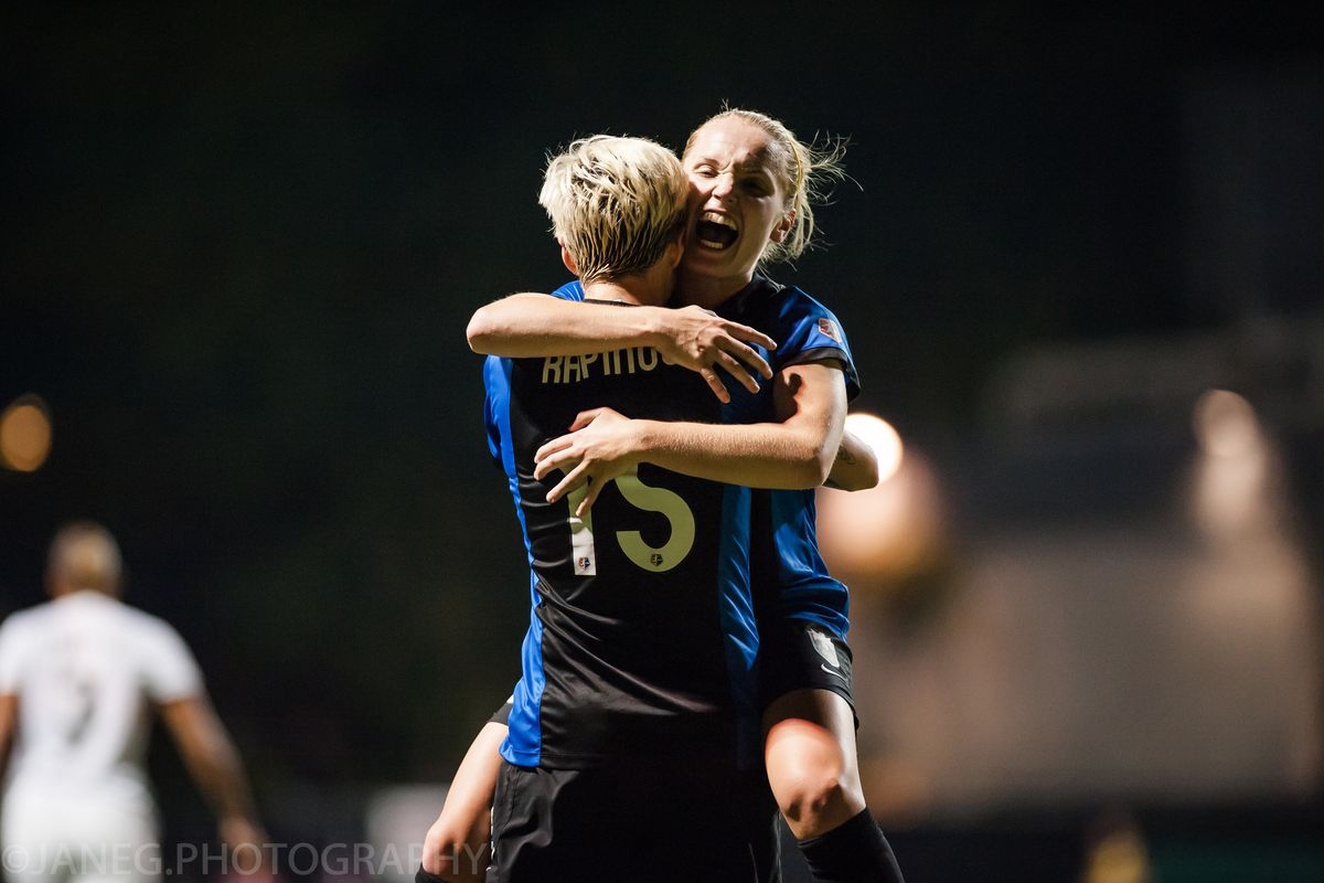 Megan Rapinoe and Kim Little celebrate the game-winning goal in the Reign's 2014 semifinal win against the Spirit.