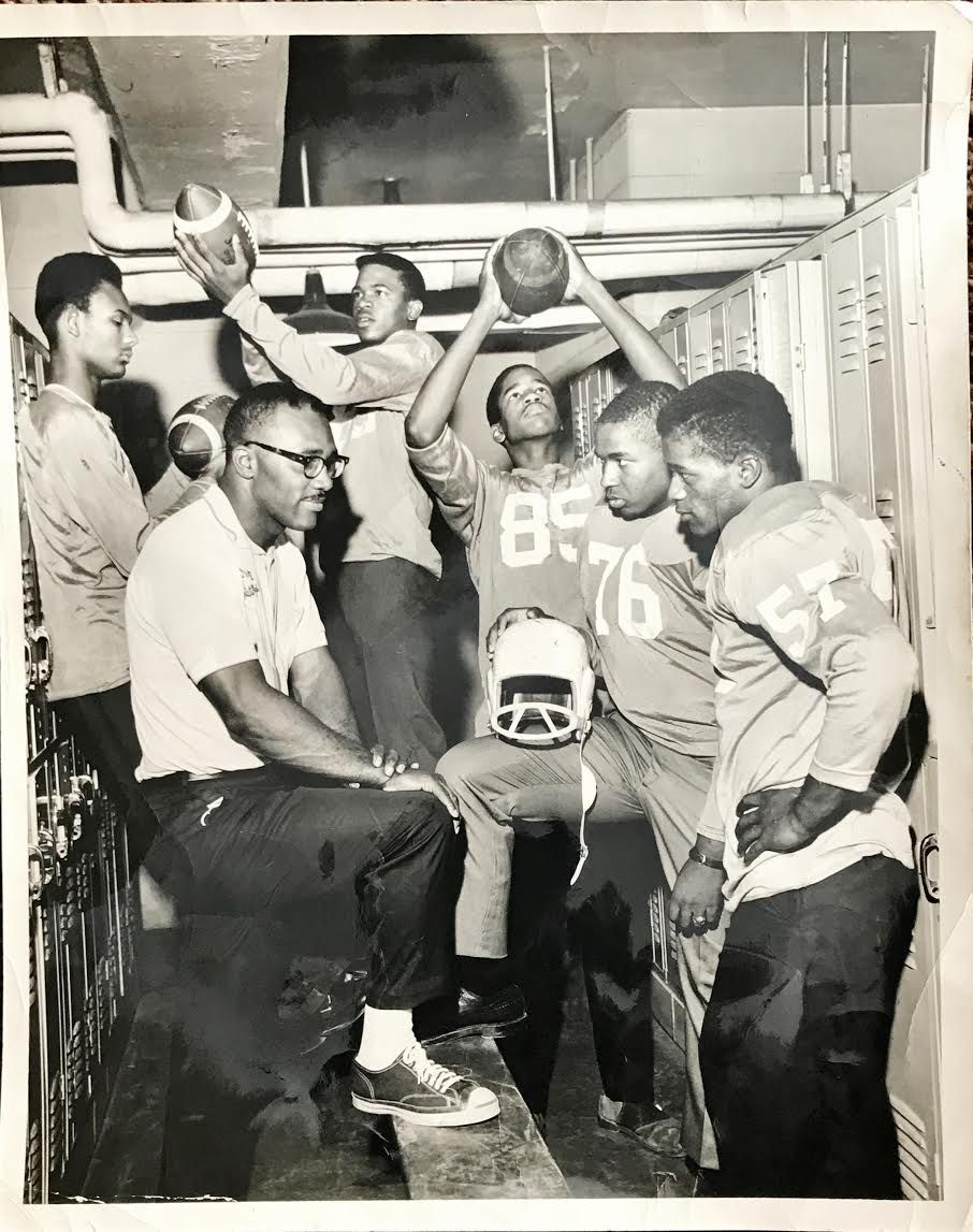 Coach Sherman Howard with players at Harlan High School circa the early 1970s.