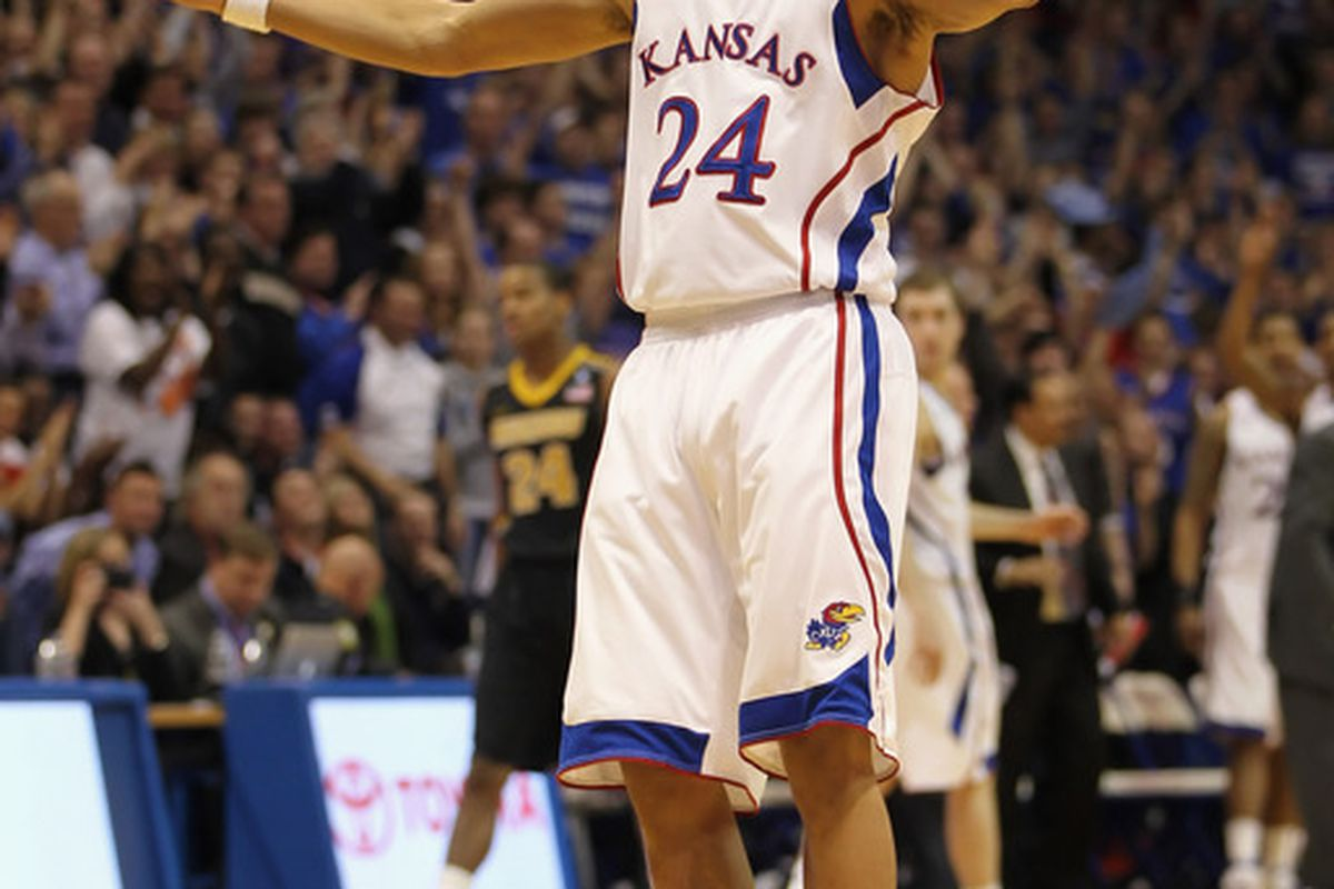 LAWRENCE KS - FEBRUARY 07:  Travis Releford #24 of the Kansas Jayhawks reacts after making a shot during the game against the Missouri Tigers on February 5 2011 at Allen Fieldhouse in Lawrence Kansas.  (Photo by Jamie Squire/Getty Images)