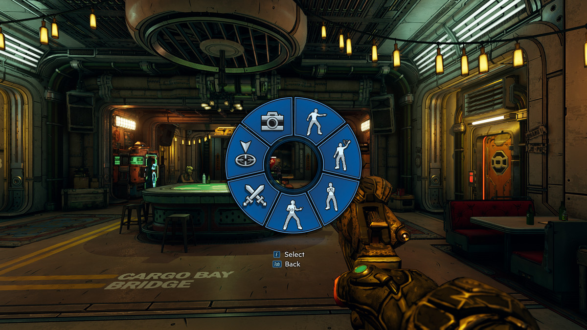 A small circular menu is in the middle of the screen and has four emote options as well as a photo mode option, a duel option, and a ping option.
