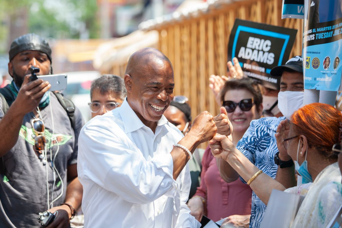 Mayoral candidate Eric Adams greets supporters in Jackson Heights, May 7, 2021.