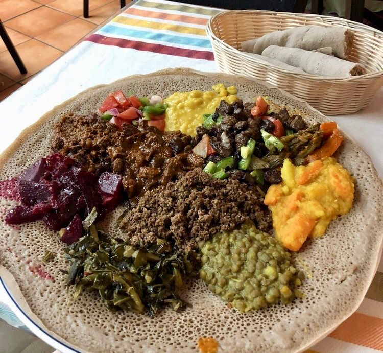 spicy split lentils, yellow peas, greens, cabbage, and chickpeas at Embilta Cafe on Cheshire Bridge