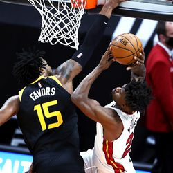 Utah Jazz center Derrick Favors (15) is called for a foul on Miami Heat forward Jimmy Butler (22) as the Utah Jazz and the Miami Heat play an NBA basketball game at Vivint Smart Home Arena in Salt Lake City on Saturday, Feb. 13, 2021.