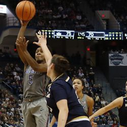 UConn's Crystal Dangerfield (5) throws up a runner  in the lane during the Notre Dame Fighting Irish vs UConn Huskies women's college basketball game in the Women's Jimmy V Classic at the XL Center in Hartford, CT on December 3, 2017.