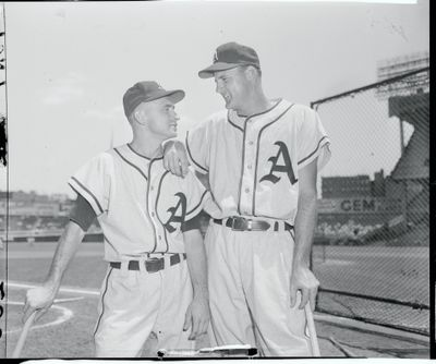 Baseball Players Smiling at Each Other