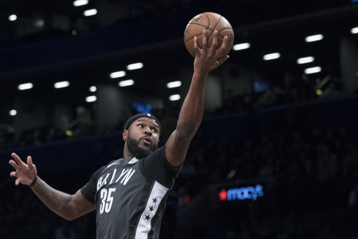 Brooklyn Nets forward Trevor Booker (35) goes to the basket during the first half of an NBA basketball game against the Atlanta Hawks, Saturday, Dec. 2, 2017, in New York. (AP Photo/Mary Altaffer)
