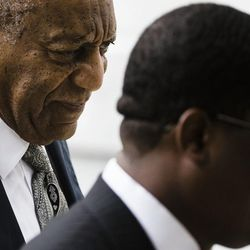 Bill Cosby, left, accompanied by Andrew Wyatt arrives for his sexual assault trial at the Montgomery County Courthouse in Norristown, Pa., Saturday, June 17, 2017.