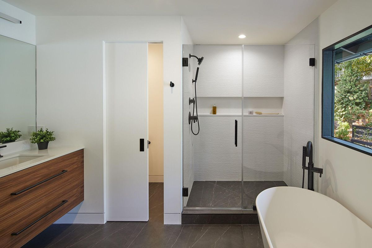 Modern bathroom with walk-in shower.