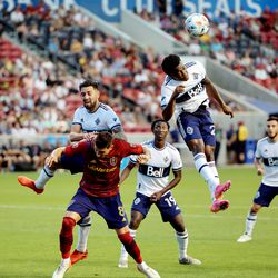 Vancouver Whitecaps defender Javain Brown (23) gets up and heads the ball away as Real Salt Lake midfielder Damir Kreilach (8) tries to get position on a corner kick as Real Salt Lake and Vancouver FC play at Rio Tinto Stadium in Sandy on Wednesday, July 7, 2021.