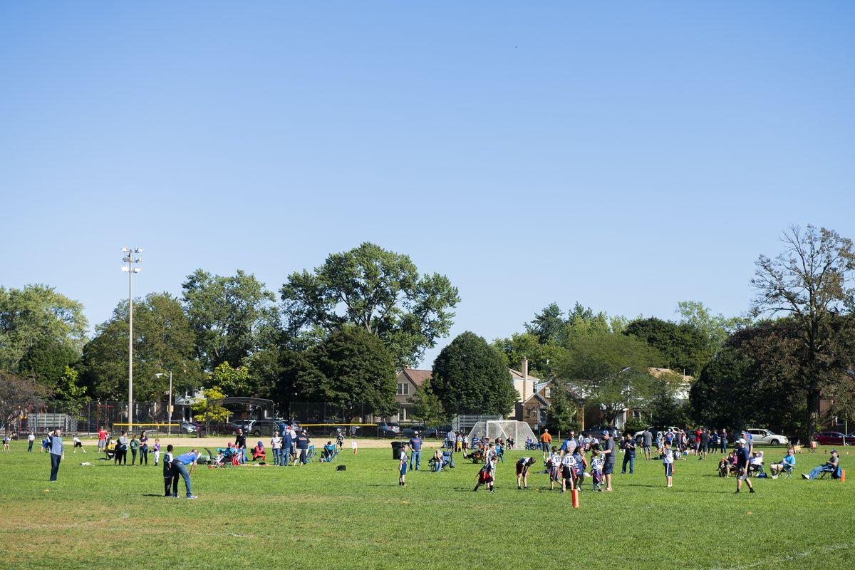Kids practice flag football at Olympia Park in Edison Park | Tyler LaRiviere/Sun-Times