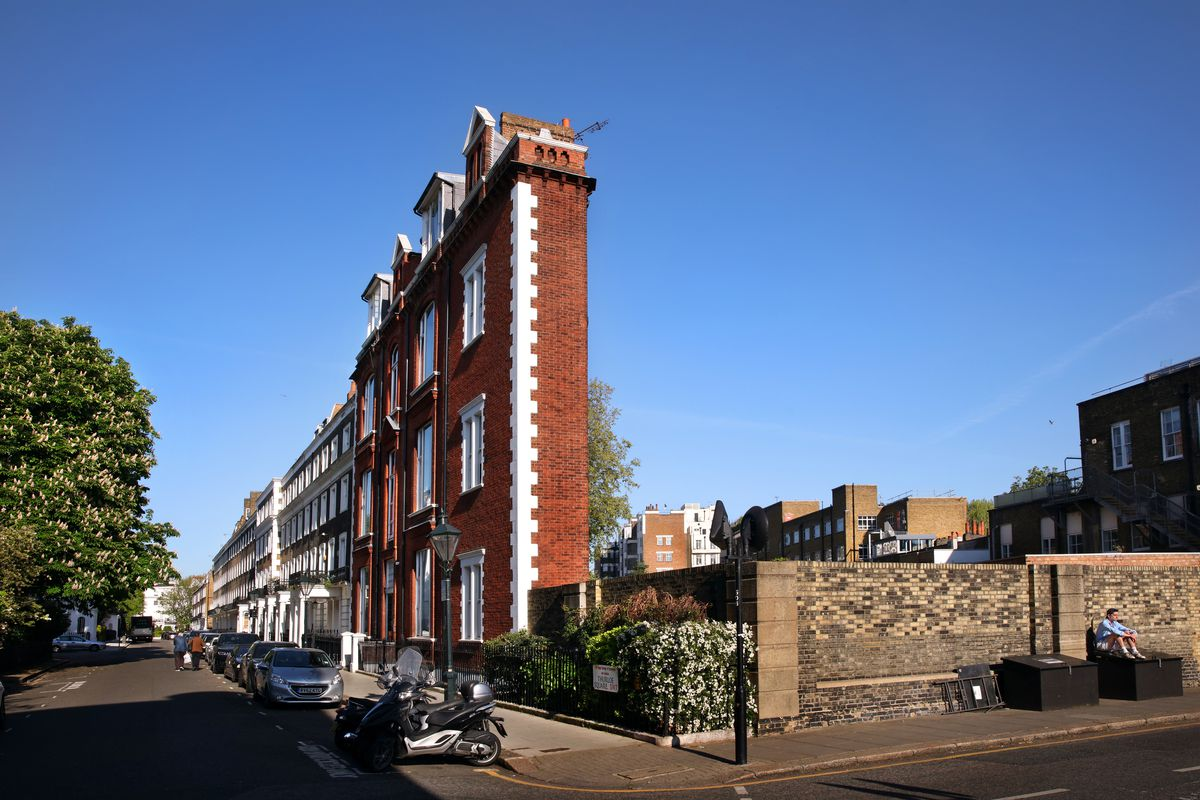 Man Sunning Himself In Front Of The Thin House In Thurloe Square London