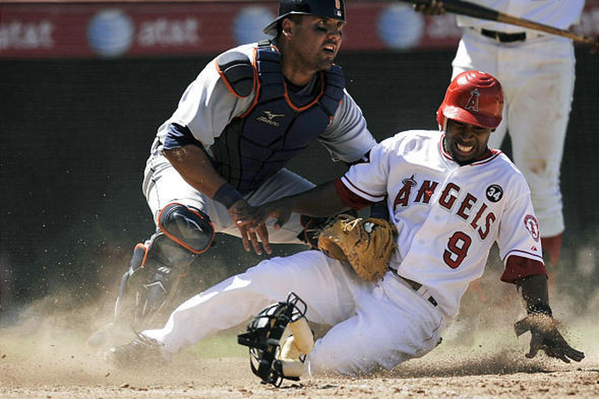 Los Angeles Angels' Chone Figgins, right, attempts to steal home plate against Detroit Tigers' Gerald Laird.