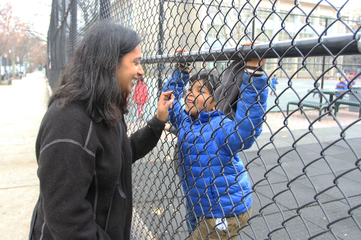 Mishi Faruqee talks to her daughter, Naima, who is in kindergarten at P.S. 38 The Pacific School in Boerum Hill, Brooklyn.