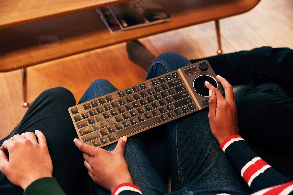 34864bb26e2 Corsair's K83 Wireless keyboard has a trackpad and half a gamepad built in
