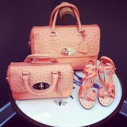 The Del Rey bag in two size options; the flower sandal