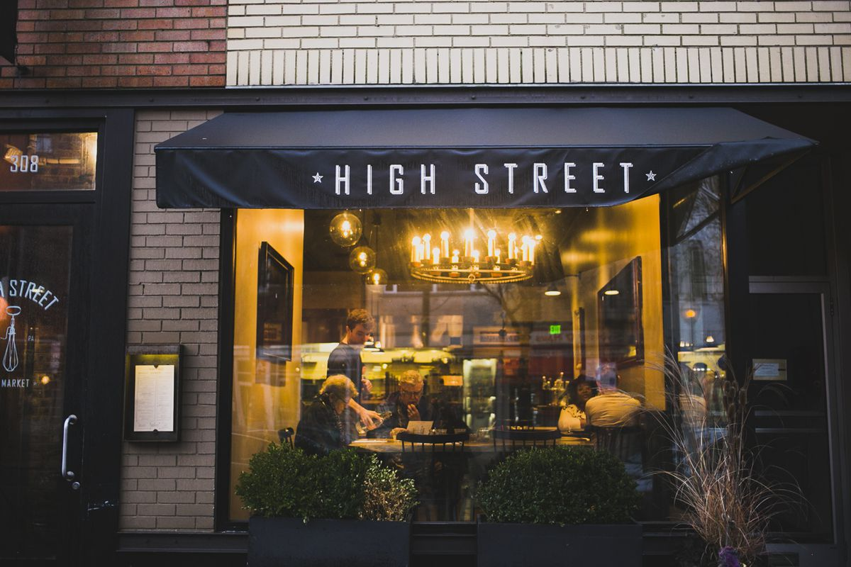 restaurant front with open windows and sign that says high street