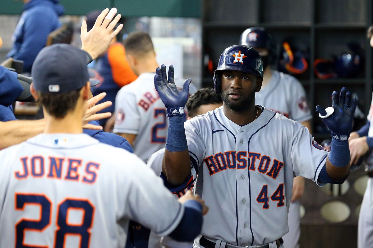 Yordan Alvarez of the Houston Astros is greeted in the dugout after a solo home run against the Texas Rangers in the fifth inning at Globe Life Field on August 29, 2021 in Arlington, Texas.