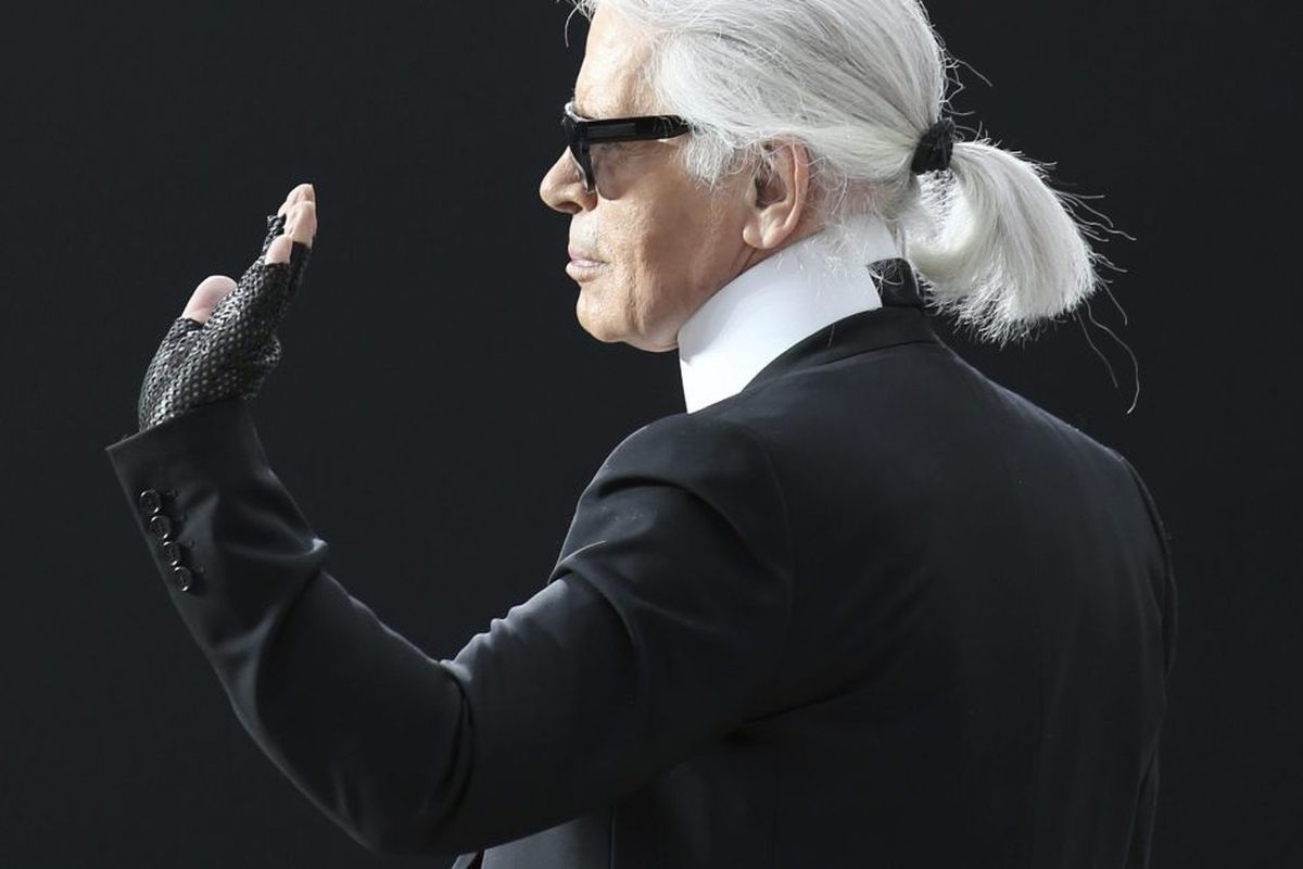e840384bb9 ... Karl Lagerfeld waves after presenting the Chanel s Fall Winter  2013-2014 ready to wear collection