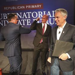 Former Utah House Speaker Greg Hughes, former Utah GOP Chairman Thomas Wright and former Gov. Jon Huntsman Jr. bump elbows after a virtual forum featuring the Republican primary gubernatorial candidates at the Grand America Hotel in Salt Lake City on Thursday, May 7, 2020.