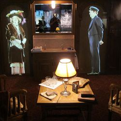Video projections of actors portraying a Titanic passenger and crewman enliven a display in the new visitor center.