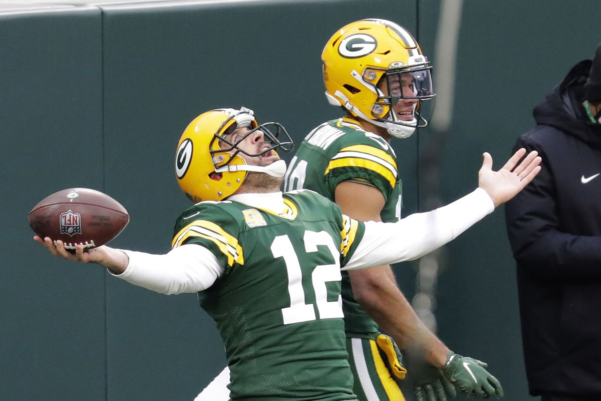 Green Bay Packers quarterback Aaron Rodgers (12) celebrates with wide receiver Equanimeous St. Brown (19) after scoring a touchdown against the Jacksonville Jaguars in the second quarter at Lambeau Field.