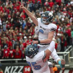Sky View lineman Evan Hall lifts quarterback Kason Carlsen into the air after Carlsen scored a touchdown during the 4A championship football game between Sky View and Park City at Rice-Eccles Stadium in Salt Lake City on Friday, Nov. 22, 2019.