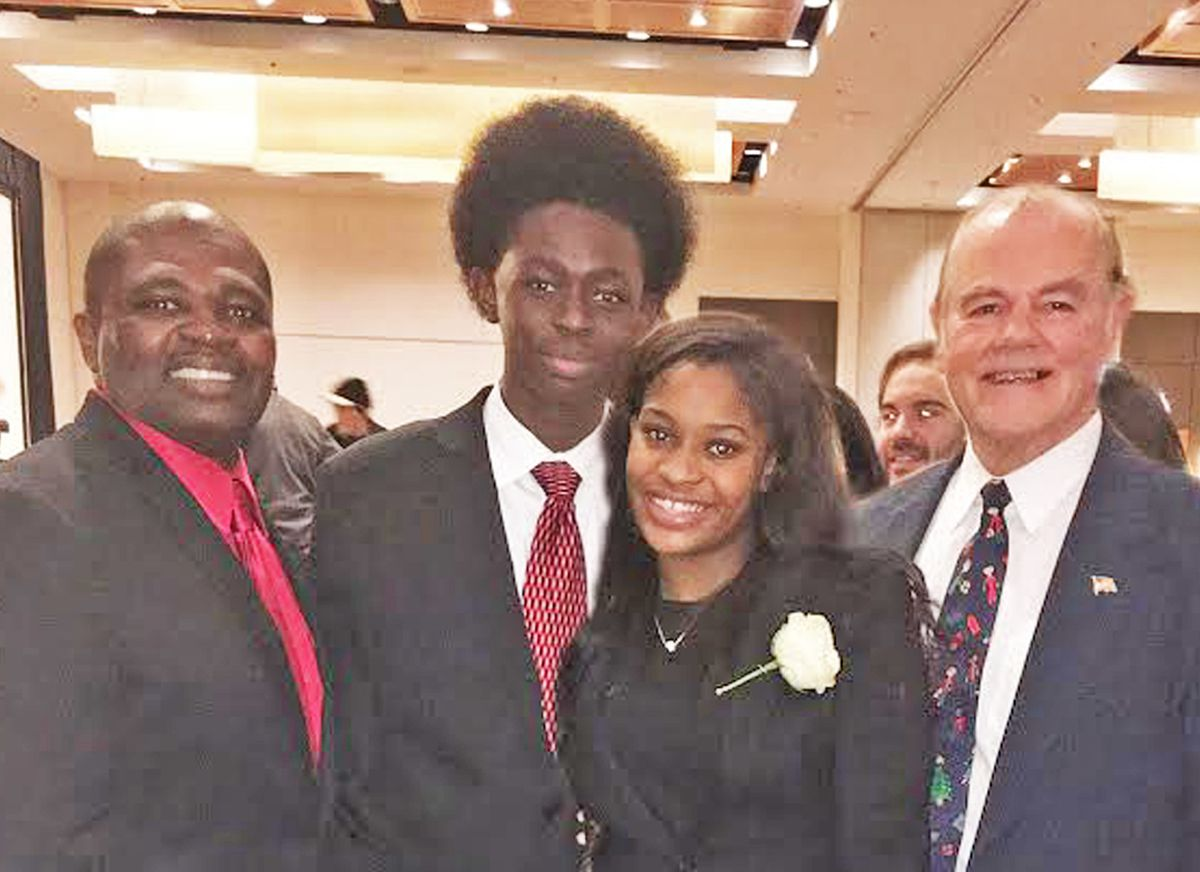 """Arnett Morris, associate executive director (left), and Ralph Campagna (right), executive director of the Off The Street Club, with Shawn Brown, 2017 """"Boy of the Year,"""" and Amariona Thomas, 2017 """"Girl of the Year,"""" at a holiday luncheon at the club, whic"""