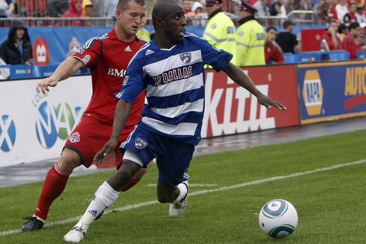 TORONTO - JULY 24: Chad Barrett #19 of Toronto FC chases down Jair Benitez #5 of FC Dallas at BMO Field during a MLS game July 24 2010 in Toronto Ontario Canada. (Photo by Abelimages/Getty Images)
