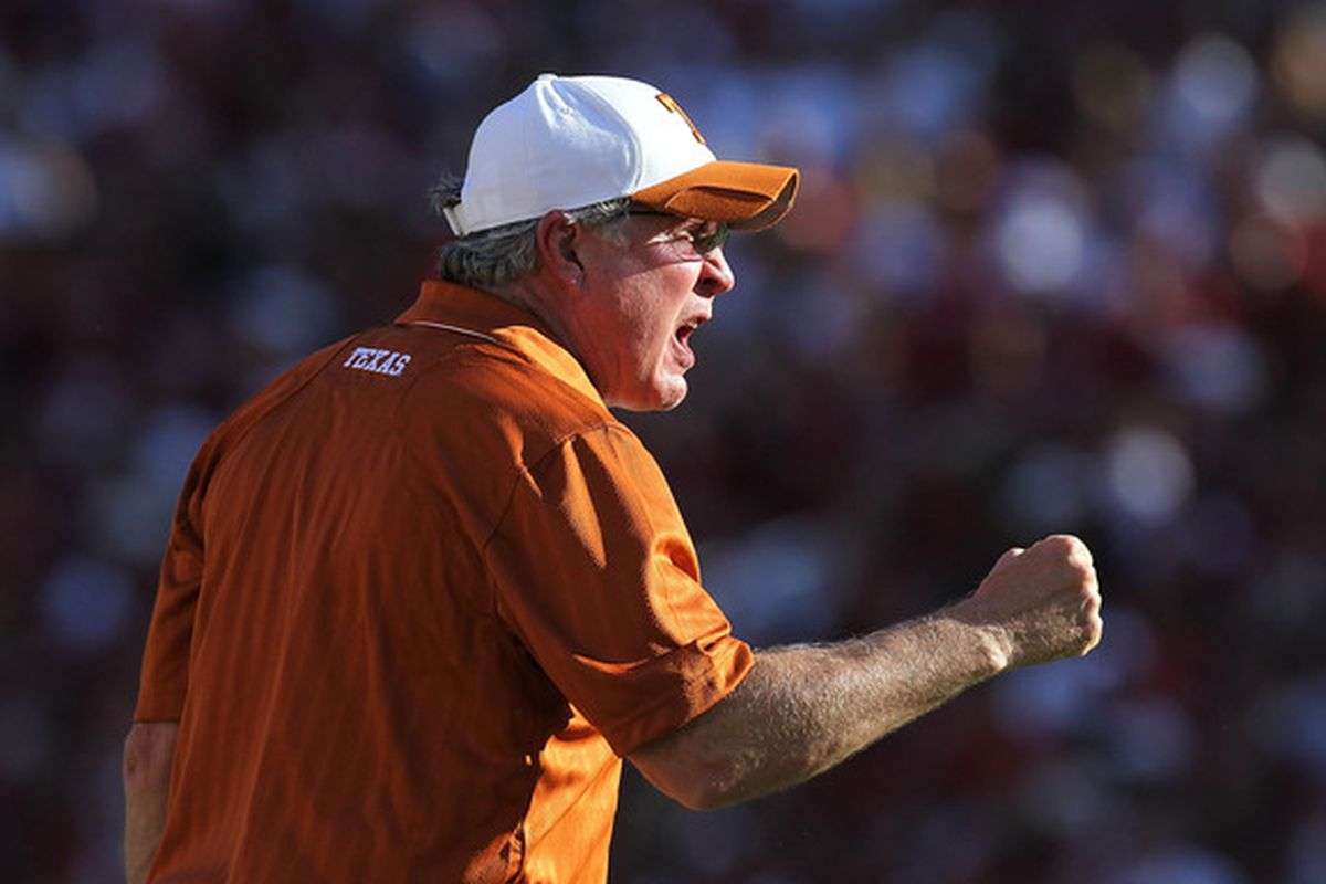 DALLAS - OCTOBER 02:  Head coach Mack Brown of the Texas Longhorns yells on the sidelines during play against the Oklahoma Sooners at the Cotton Bowl on October 2 2010 in Dallas Texas.  (Photo by Ronald Martinez/Getty Images)