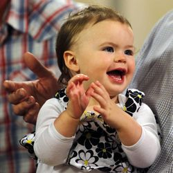 Lily Groesbeck, 18 months, survived 14 hours trapped in a car upside down in the Spanish Fork River. She is held by her grandfather Chad Groesbeck during an interview in Salt Lake City, Monday, March 16, 2015.