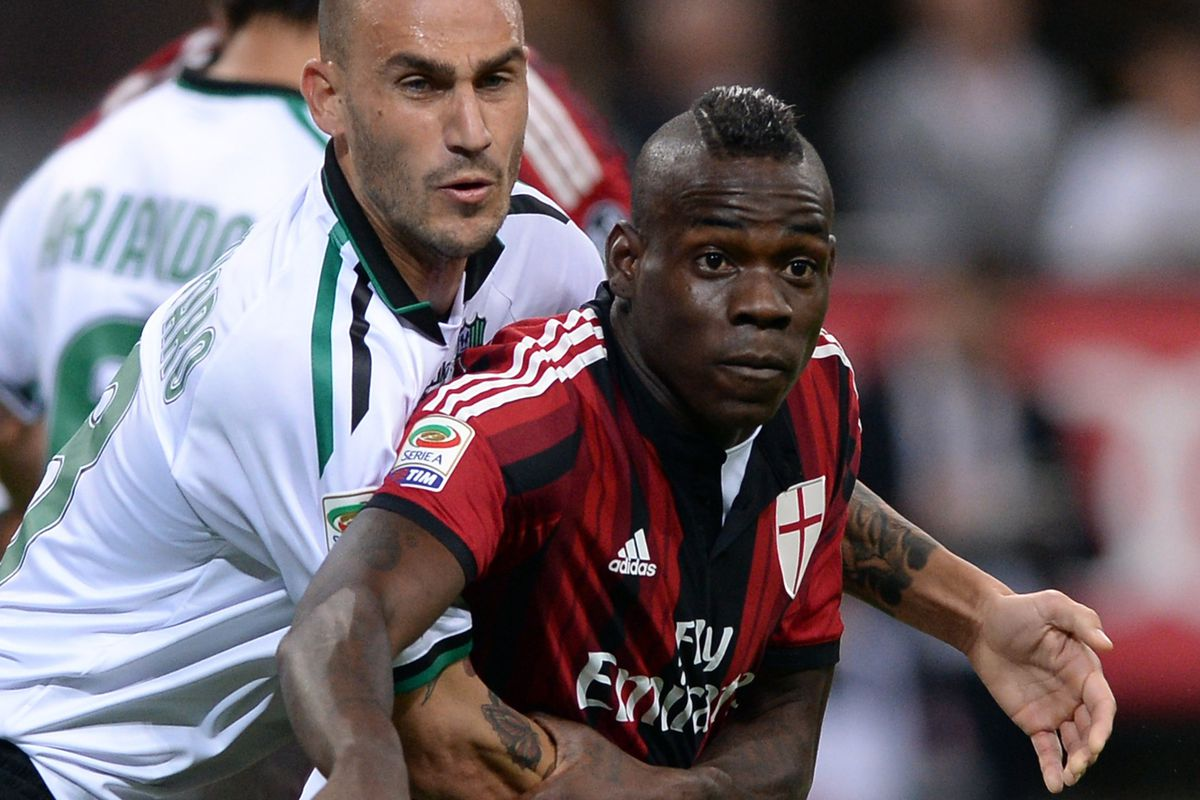 Even opponents kindly oblige Mario Balotelli's need for hugs.