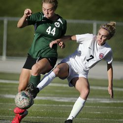 Olympus' Megan Jewell and Brighton's Kate Munger compete in the 5A high school girls soccer quarterfinals at Olympus High School in Holladay on Thursday, Oct. 15, 2020.