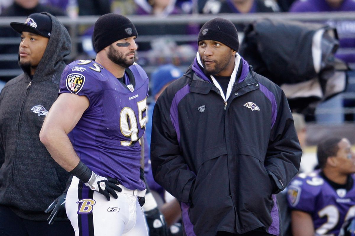 BALTIMORE, MD:  Jarret Johnson #95 and  Ray Lewis #52 of the Baltimore Ravens talk on the sidelines during the second half against the Indianapolis Colts at M&T Bank Stadium in Baltimore, Maryland.  (Photo by Rob Carr/Getty Images)
