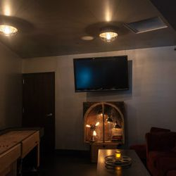Upstairs lounge features a shuffleboard table, as well as a photo booth from Las Vegas (not picture).