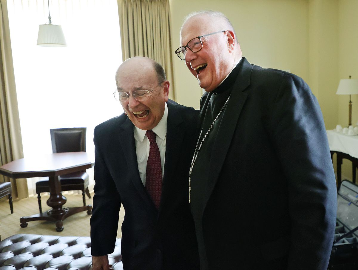 Elder Quentin L. Cook, a member of the Quorum of the Twelve Apostles of The Church of Jesus Christ of Latter-day Saints, left, and Cardinal Timothy Dolan, archbishop of New York, laugh during an interview during the Notre Dame Religious Liberty Summit at the University of Notre Dame in South Bend, Ind., on Monday, June 28, 2021.