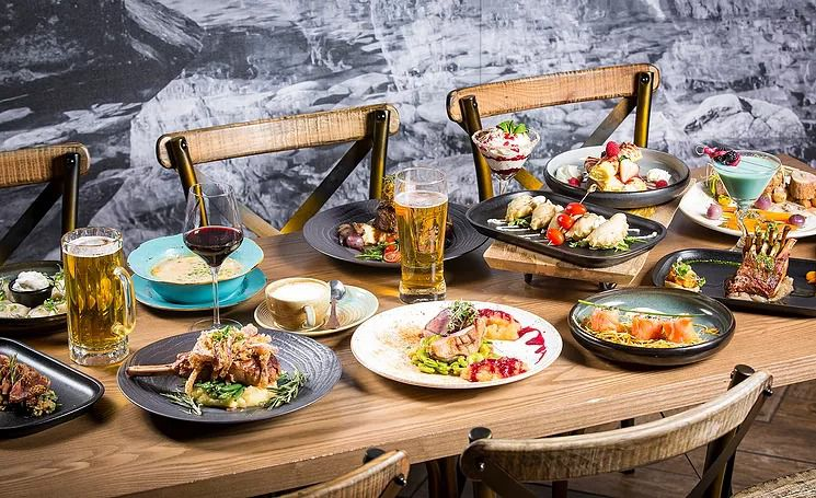 A variety of Polish dishes and drinks spread out on a table.