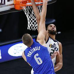 Dallas Mavericks forward Kristaps Porzingis (6) dunks over Utah Jazz center Rudy Gobert (27) as the Utah Jazz and the Dallas Mavericks play an NBA basketball game at Vivint Smart Home Arena in Salt Lake City on Wednesday, Jan. 27, 2021. Jazz won 116-104.