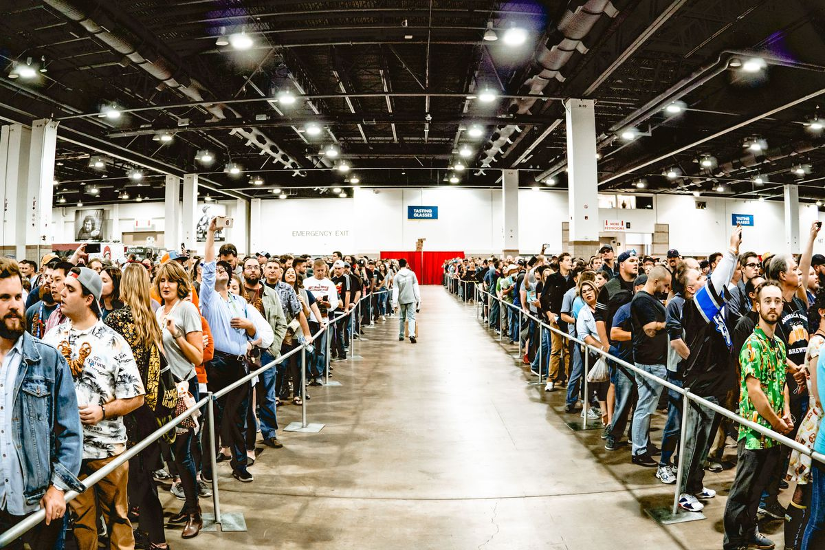A photo of people arranged in two large queues to enter the Great American Beer Festival