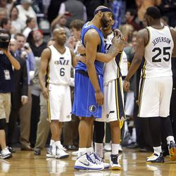 After the three overtime game Utah Jazz guard Devin Harris (5) and Dallas Mavericks guard Vince Carter (25) hug as the Utah Jazz defeats the Dallas Mavericks 123-121 Monday, April 16, 2012 in Salt Lake City.