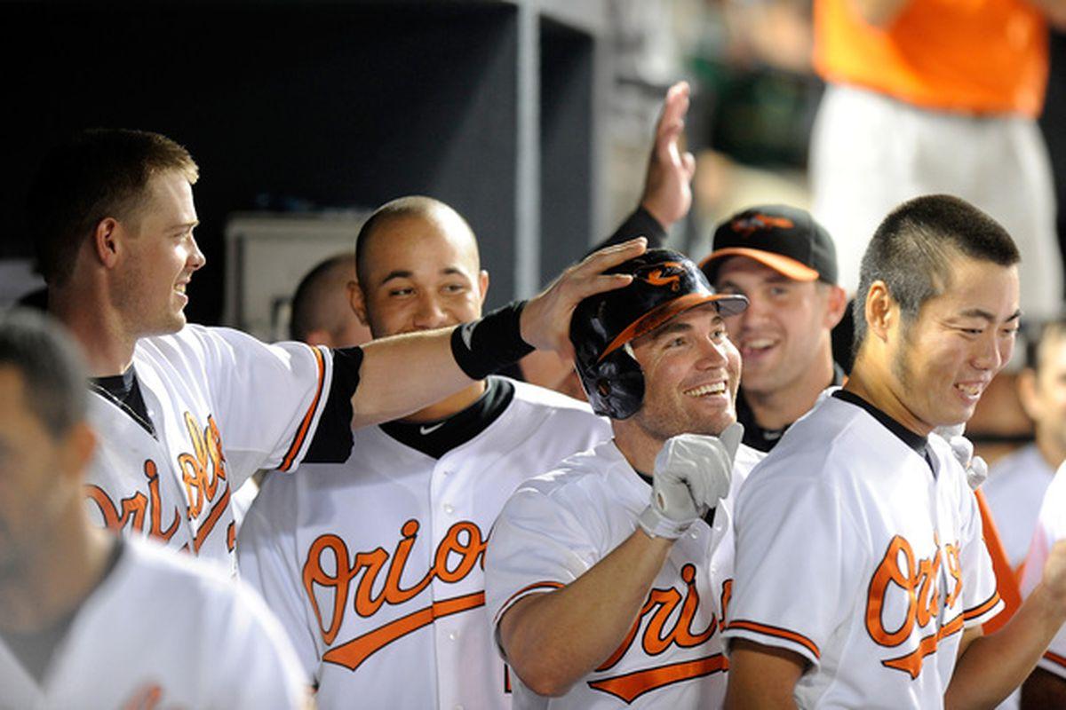 Matt Wieters lays hands on Luke Scott, blessing him with the gift of happy home runs.